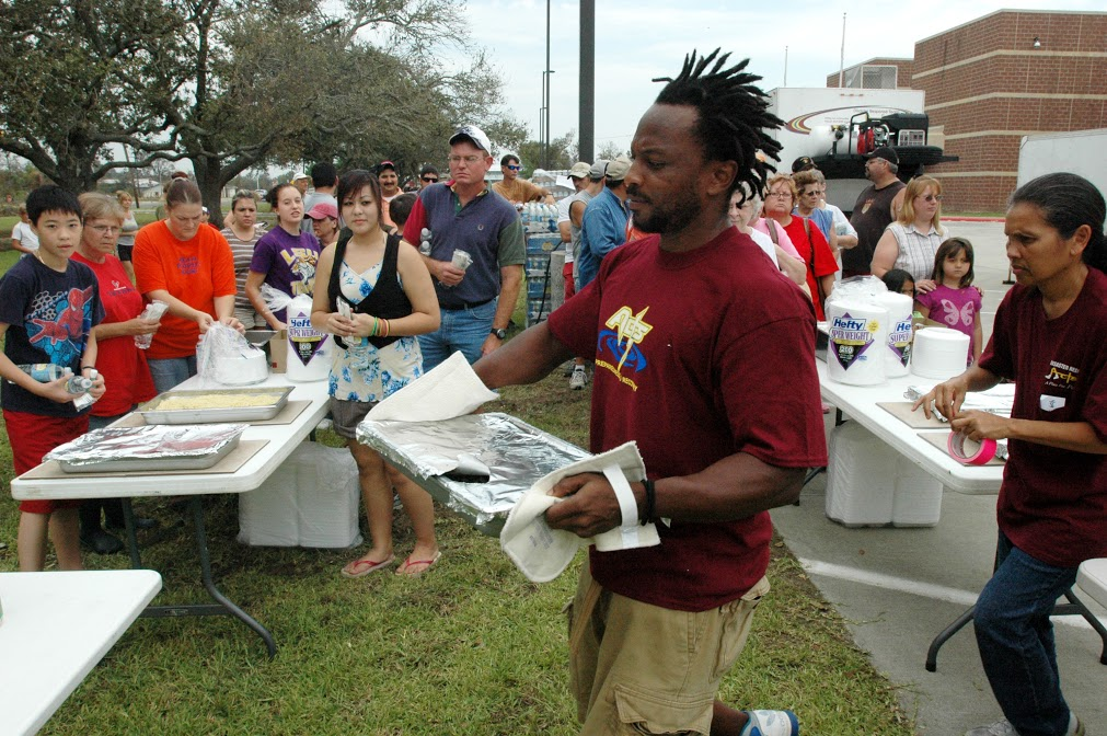 Bridge City, TX, September 18, 2008 - Volunteers from the faith based agency ACTS prepare and distribute food to residents affected by Hurricane Ike. The Federal Emergency Managment Agency (FEMA) works with volunteer organizations to provide immediate aid to victims of major disasters. Leif Skoogfors/FEMAThe Federal Emergency Managment Agency (FEMA) works closely with volunteer agencies to provide much needed help in the immediate aftermath of a disaster. Leif Skoogfors/FEMA