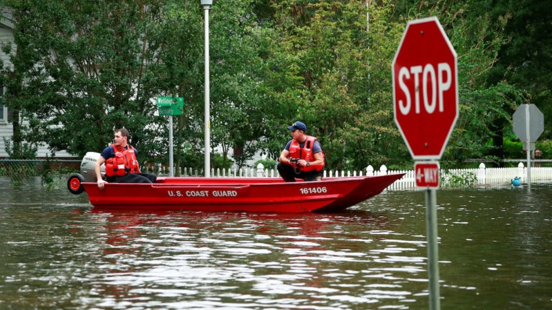 The U.S. Coast Guard searched for and rescued many residents from the Hurricane Florence's flood waters -- here in a Lumberton, North Carolina neighborhood.
