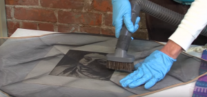 Surface clean your artwork with a vacuum with a brush attachment