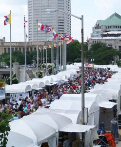 Overhead view of busy outdoor art show in a city setting