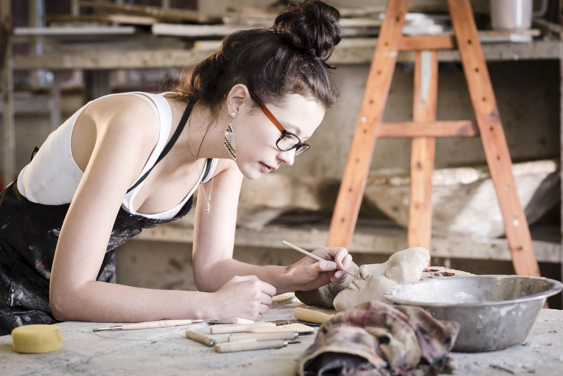 cerf-young-artist-moulding-raw-clay-in-art-studio