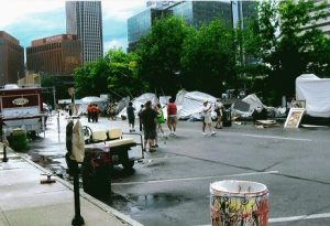 Downtown Omaha, NE scene after a tornado. Artists beginning to clean up damaged displays and artwork.